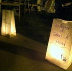 Luminaria bags were placed along the track in memory of those affected by Cancer.