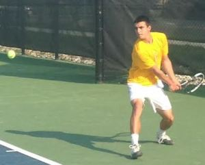 Eric Spangler prepares to return a serve from CNU.