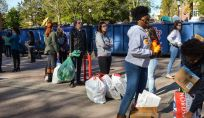 Hannah Wichrowski photo. Students line up in Red Square to weigh their recyclables.